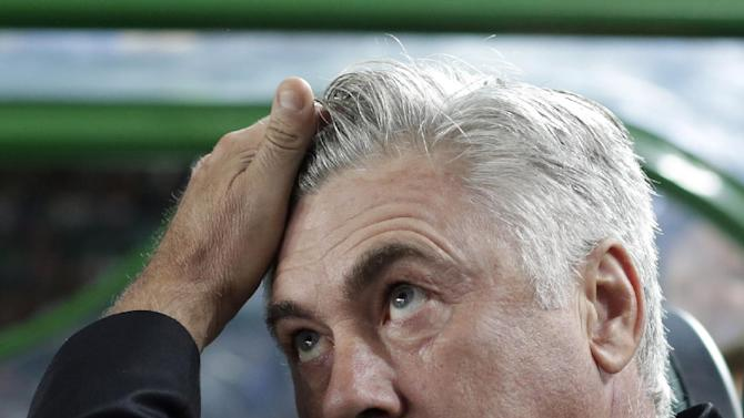 Real Madrid's coach Carlo Ancelotti from Italy awaits the start of their La Liga soccer match against Elhe at the Martinez Valero stadium in Elche, Spain, Wednesday, Sept. 25, 2013