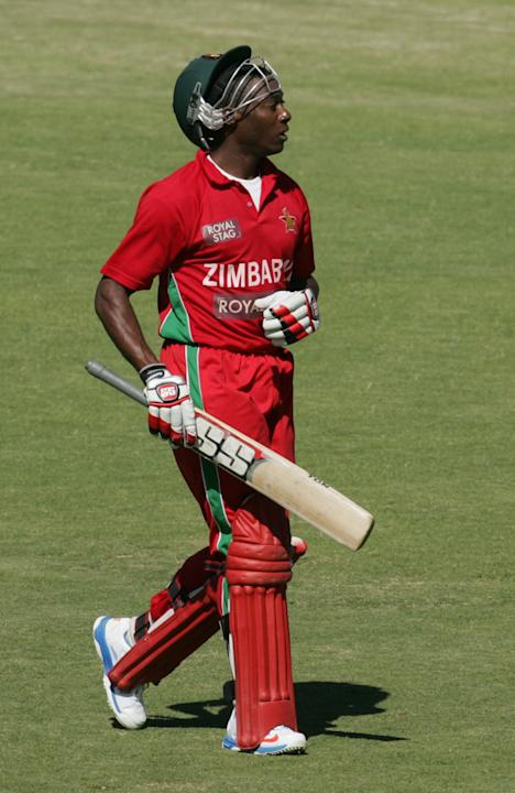 Zimbabwe batsman Vusimuzi Sibanda walks off the pitch after loosing his wicket during the first of five ODI series match between India and Zimbabwe at the Harare Sports Club on 24 July, 2013. AFP PHOT