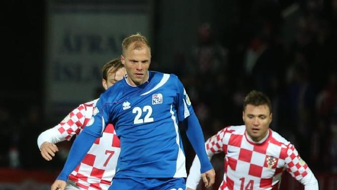 Iceland's Eidur Smari Gudjohnsen controls the ball during their World Cup qualifying playoff first leg soccer match against Croatia in Reykjavik, Iceland, Friday Nov. 15, 2013