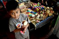 This is mine: A kid with a vintage wooden toys. playing and having fun is very simple thing in the past. (