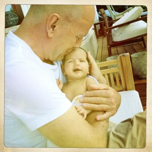 """Celebrity photos: Bruce Willis' wife Emma Heming-Willis tweeted this gorgeous photo of Bruce with their baby, Mabel Ray. Emma captioned the photo: """"A beautiful day in Budapest with the loves of my lif"""