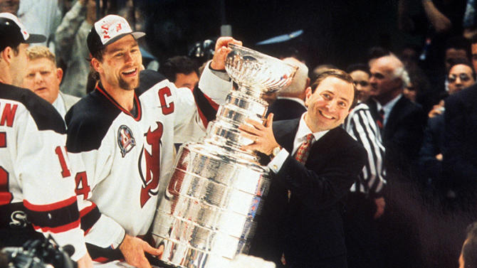 NHL commissioner Gary Bettman awards the Stanley Cup to New Jersey Devils captain Scott Stevens in 1995