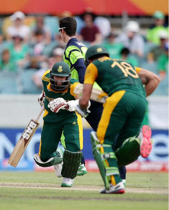 South Africa's Hashim Amla, left, and batting partner Francois Du Plessis run between the wickets during their Cricket World Cup Pool B match against Ireland in Canberra, Australia, Tuesday, March