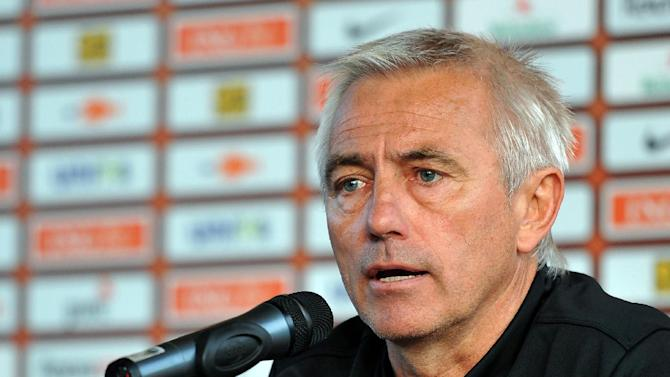 In this June 6, 2012 file photo Dutch head coach Bert van Marwijk addresses the media after a training session of the Netherlands at the Euro 2012 soccer championships in Krakow, Poland. Hamburger SV has appointed van Marwijk to replace the fired Thorsten Fink. The former Netherlands coach agreed to a deal through June 2015, the Bundesliga club announced on its website late Monday, Sept. 23, 2013