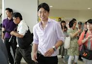 Japanese midfielder Shinji Kagawa at the Kansai international airport in Osaka for his flight to London on July 10. Kagawa has vowed to secure a starting slot when the Premier League season kicks off in August