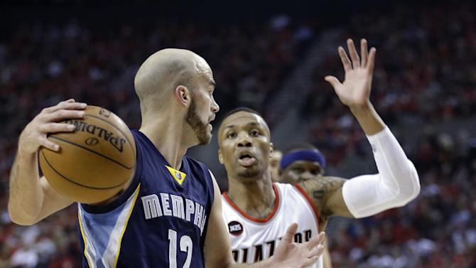 Memphis Grizzlies guard Nick Calathes (12) looks to pass as Portland Trail Blazers guard Damian Lillard defends during the first half in Game 4 of a first-round NBA basketball playoff series Monday, April 27, 2015, in Portland, Ore. (AP Photo/Don Ryan)