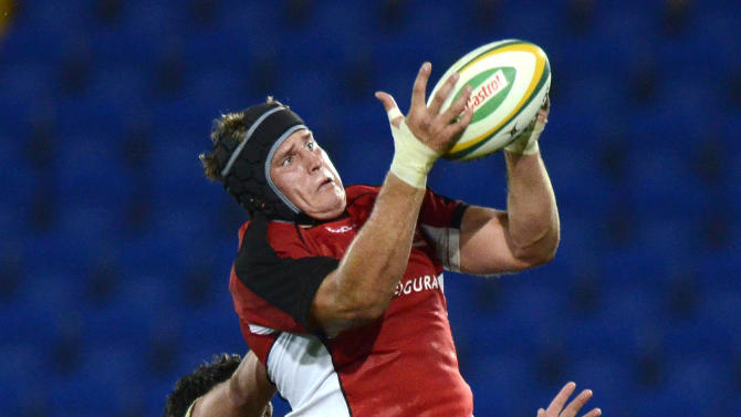 Canada's Tyler Hotson jumps in the linout during their rugby union match against the Australian Barbarians on the Gold Coast, Australia, Friday, Aug. 26, 2011. (AP Photo/Steve Holland)