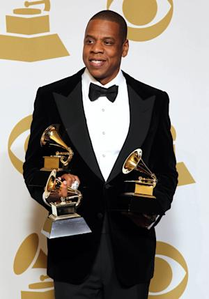 "FILE - In this Feb. 10, 2013 file photo, Jay-Z poses backstage with the awards for best rap/sung collaboration for ""No Church in the Wild"" and best rap performance for ""N****s in Paris"" at the 55th annual Grammy Awards, in Los Angeles.  Jay-Z is among 11 celebrities and government officials whose private financial information appears to have been posted online by a site that began garnering attention on Monday, March 11, 2013. (Photo by Matt Sayles/Invision/AP, File)"