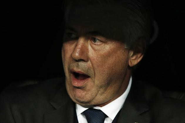 Real Madrid's coach Carlo Ancelotti gestures before the kick off of a Spanish La Liga soccer match between Real Madrid and Villarreal at the Santiago Bernabeu stadium in Madrid, Spain, Sunday, Mar