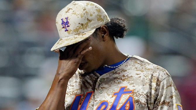 New York Mets pitcher Jenrry Mejia reacts after allowing the Atlanta Braves to score the go-ahead run in New York