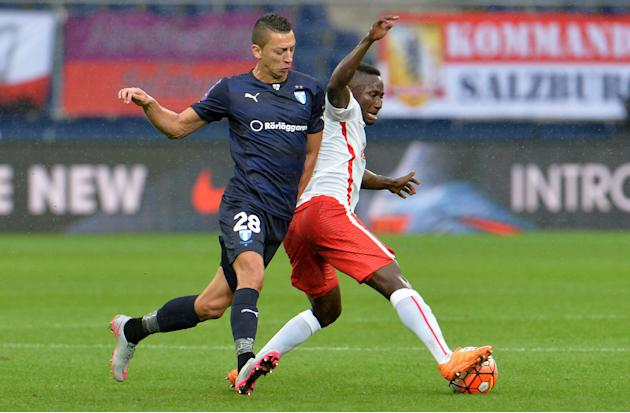 Salzburg's Naby Keita, right, and Malmo's Nikola Djurdic challenge for the ball during the Champions League third qualifying round first leg soccer match between Red Bull Salzburg and Malmo FF