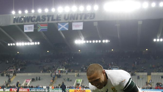South Africa's Bryan Habana and his son at the end of the match