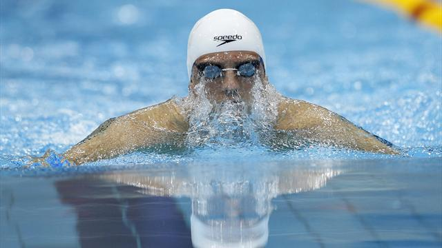 Swimming - Britain's swimmers 'will learn from funding cut'