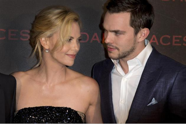 """Actors Charlize Theron, left, and Nicholas Hoult pose during a photocall for the French premiere of """"Dark Places"""" by French director Gilles Paquet-Brenner, in Paris, France, Tuesday, March 3"""