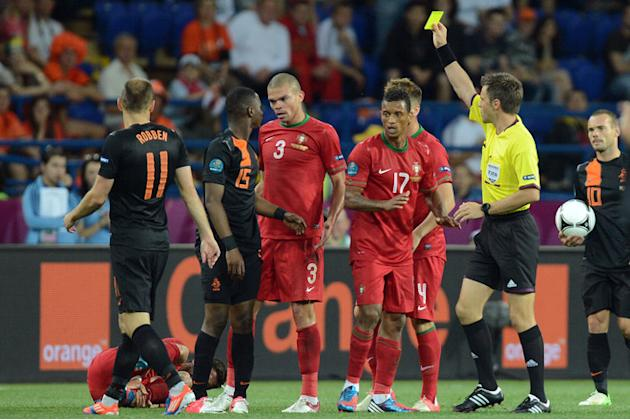 Italian Referee Nicola Rizzoli (R) Shows AFP/Getty Images