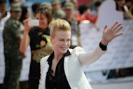 "Actress Nicole Kidman of Australia waves during a red carpet event at a groundbreaking ceremony for the ambitious ""Oriental Movie Metropolis"", billed as China's answer to Hollywood, in the Eastern port city of Qingdao on September 22, 2013. Kidman, Leonardo DiCaprio and John Travolta on Sunday added their star power to the glitzy inauguration"