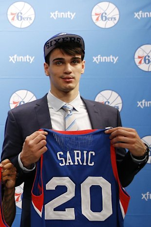 Newly-drafted Philadelphia 76ers' Dario Saric poses for a photo after a basketball news conference at the team's practice facility, Saturday, June 28, 2014, in Philadelphia. (AP Photo/Matt Slocum)
