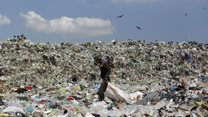 A man looks for usable items in a dumpsite on the outskirts of Tegucigalpa