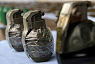 This file illustration photo shows hand grenades. A man who lost a coin-tossing gambling game at a carnival in the Philippines hurled a grenade at other players, killing a teenager and injuring 22 people, according to police