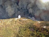 Photo taken on January 13, 2013 and provided by the New South Wales Rural Fire Service (RFS) shows smoke billowing from a fire near the Siding Spring Observatory. The RFS said that the main Anglo-Australian Telescope appear to have survived