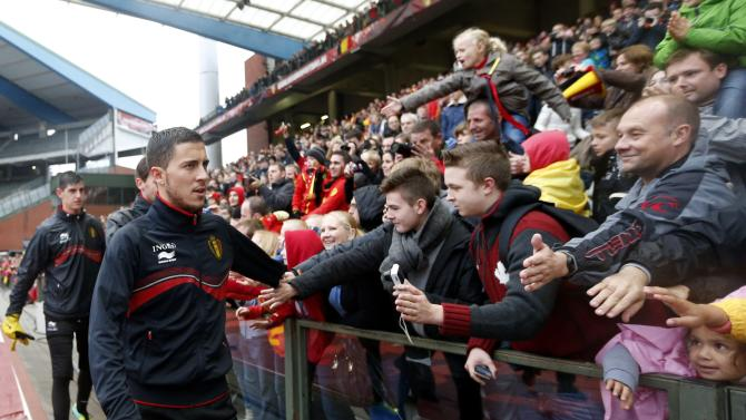Belgium's soccer team player Hazard greets supporters during a training session in Brussels