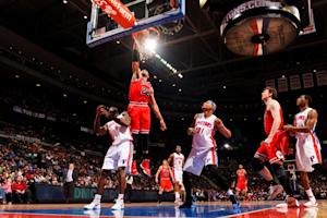 Rose hits tying 3, Bulls beat Pistons 100-94 in OT
