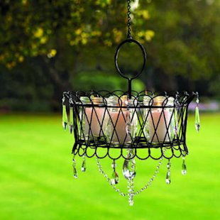 Wire basket and mason jars become outdoor chandelier