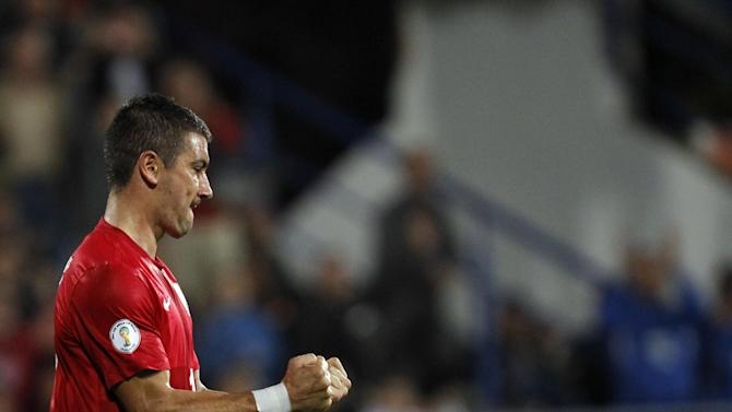 Serbia's Aleksandar Kolarov celebrates after scoring during their World Cup 2014 Group A qualifying soccer match against Macedonia, at the City Stadium in Jagodina, Serbia, Tuesday, Oct. 15, 2013