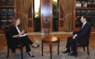 Syria's President Bashar al-Assad speaks during an interview with Italian television station RaiNews24 in Damascus in this handout photograph distributed by Syria's national news agency SANA on September 29, 2013. REUTERS/SANA/Handout via Reuters