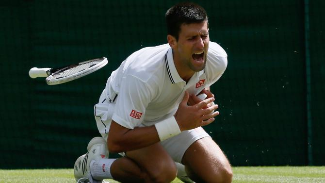 Wimbledon men - Novak Djokovic through despite injury scare, Berdych falls in late-night thriller