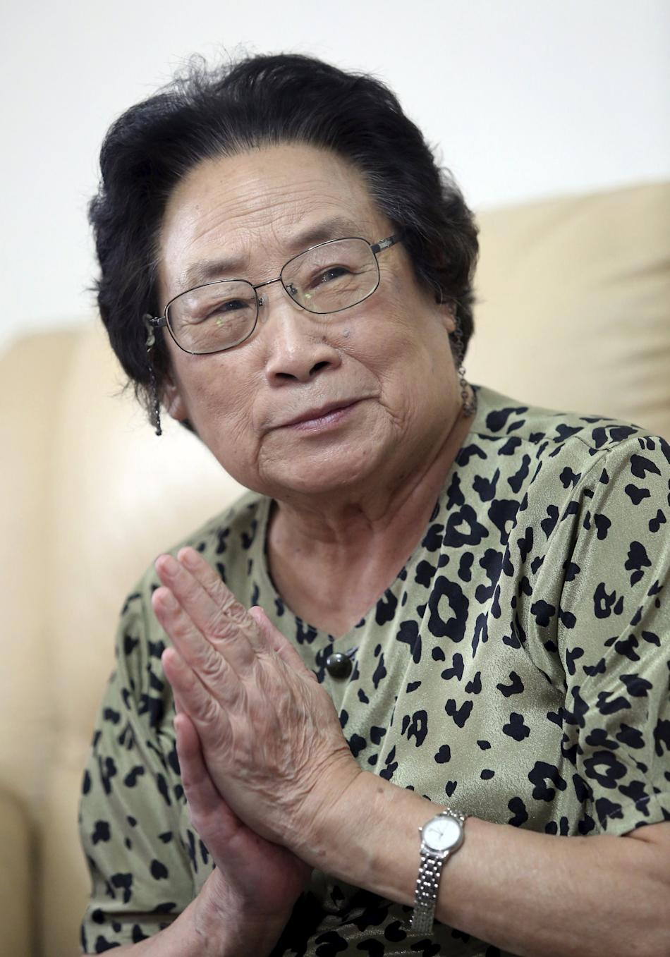 Tu Youyou, one of the three awardees for the 2015 Nobel Prize for Medicine, gestures during a meeting at her home, in Beijing