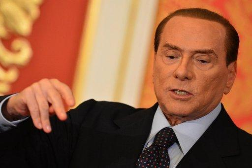 Former Italian premier Silvio Berlusconi speaks during a press conference in Monza on October 27. Italian police say Berlusconi's accountant was taken hostage in his home by armed intruders who demanded a 35 million euro ($44 million) ransom from the ex-premier.