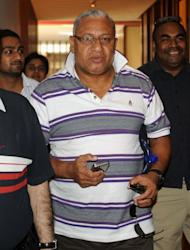 """Fiji Prime Minister Voreqe Bainimarama (C) in the Indian city of Amritsar on April 27, 2012. He has warned the storm is an """"impending disaster"""" and offers of international aid have already been received"""