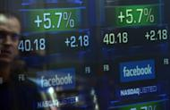 Screens display the start of trading in Facebook shares at the NASDAQ stock exchange in May. Brokers and industry experts told a congressional panel that the flash crash of May 6, 2010, the computer glitch that sabotaged Facebook's IPO last May was an examples of the potential for disaster from ultra high-speed, high-frequency trading (HFY).