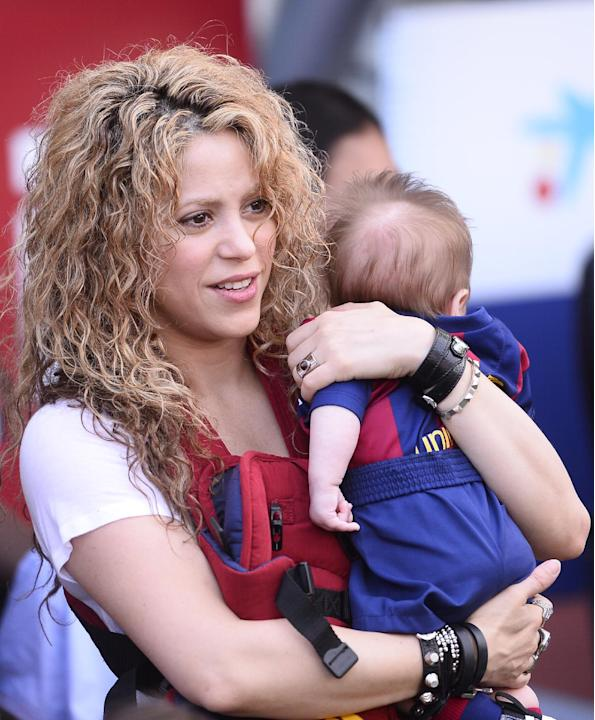 FILE - In this April 18, 2015 file photo, Colombian singer Shakira holds her son Sasha prior to a Spanish La Liga soccer match between FC Barcelona and Valencia at the Camp Nou stadium in Barcelona, S