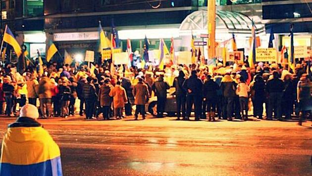 Thousands gathered outside the Ukrainian Consulate in Toronto on Tuesday, to call for a peaceful solution to violence in Kyiv.