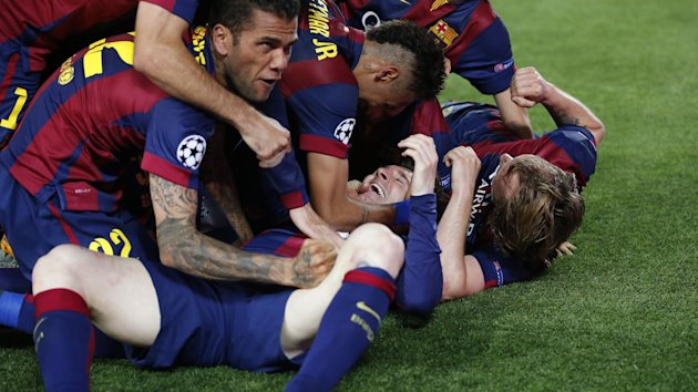 Barcelona's Lionel Messi celebrates with team mates after scoring their second goal