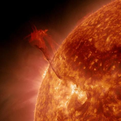 "A huge filament of super-hot plasma, nicknamed the ""Dragon Tail,"" erupts from the sun on Jan. 31, 2013, in this still image from NASA's Solar Dynamics Observatory."