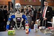 A robot said to be able to cook takes stock of groceries at CeBIT, the world's biggest high-tech fair on March 6, 2012 in Hanover, Germany. Water-powered clocks, eye-controlled arcade games and pole-dancing robots: this year's CeBIT tech fair, the world's biggest, showcased gadgets ranging from the useful to the downright nerdy