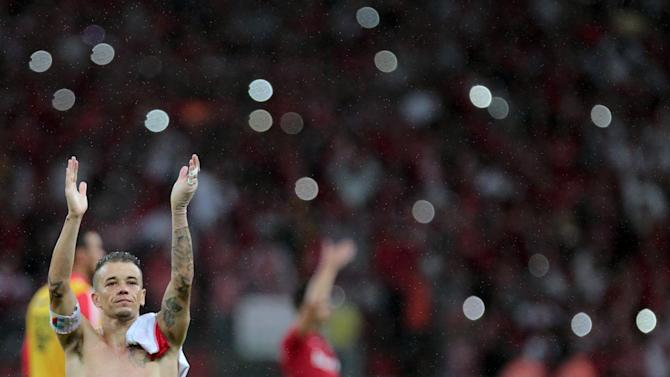 D'Alessandro of Brazil's Internacional celebrates after winning his Copa Libertadores soccer match against Colombia's Santa Fe in Porto Alegre