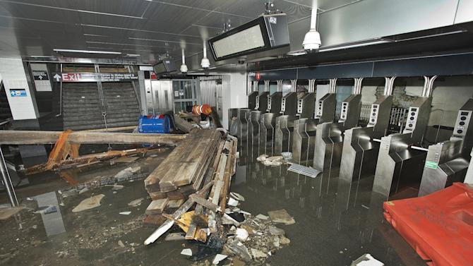 FILE - In this Oct. 30 2012 file photo provided by the Metropolitan Transportation Authority, the South Ferry subway station in New York City is filled with seawater and debris from Superstorm Sandy. A presidential task force charged with developing a strategy for rebuilding coastal areas damaged by Sandy will issue a report on Monday, Aug. 19, 2013, recommending 69 measures that might help insure that coastal areas aren't as vulnerable to future storms in an age of rising sea levels. (AP Photo/ Metropolitan Transportation Authority, Patrick Cashin, File)