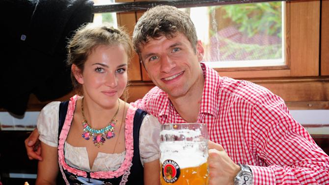 Thomas Mueller of Bayern Munich, right, and his wife Lisa Mueller attend the Oktoberfest beer festival in Munich southern Germany, Sunday, Oct 6, 2013