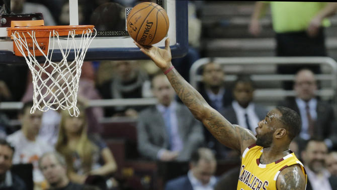 Cleveland Cavaliers' LeBron James (23) drives to the basket against Los Angeles Lakers' Kobe Bryant (24) in the first half of an NBA basketball game Wednesday, Feb. 10, 2016, in Cleveland. (AP Photo/Tony Dejak)