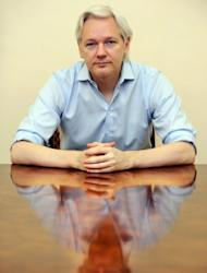 Wikileaks founder Julian Assange speaks to the media inside the Ecuadorian Embassy in London on June 14, 2013. Assange, whose organization leaked a vast trove of diplomatic cables and Iraq and Afghanistan war logs a few years ago, has been staying in the Ecuadoran embassy in London for a year