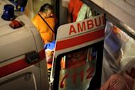 Former Romanian Prime Minister Adrian Nastase is loaded into an ambulance by emergency workers in Bucharest. Nastase attempted suicide Wednesday, hours after the Supreme Court threw out his appeal against a two-year jail sentence over corruption