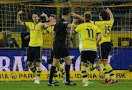 Dortmund's players celebrate after scoring second goal during their German first division Bundesliga match against Borussia Moenchengladbach, in Dortmund, western Germany, on September 29. Dortmund are looking to build on their 5-0 domestic thumping of Borussia M'gladbach last weekend when they travel to Hanover next, on Sunday