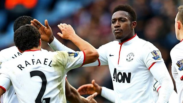 Danny Welbeck of Manchester United (19) is by congratulated by Rafael da Silva (2) and team mates (Getty Images)