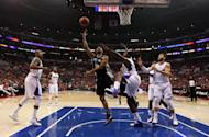 Tony Parker of the San Antonio Spurs shoots over DeAndre Jordan and Blake Griffin of the Los Angeles Clippers in Game Three of the Western Conference Semifinals in the 2012 NBA Playoffs, on May 19, at Staples Center in Los Angeles, California. The Spurs won 96-86