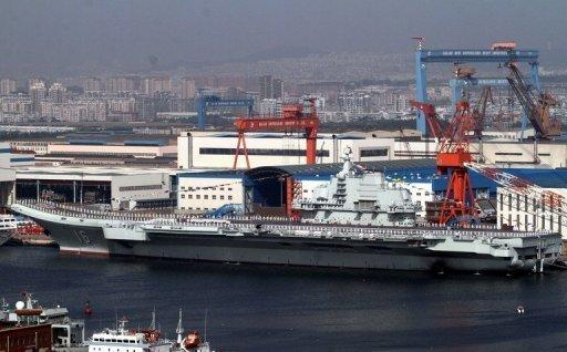 China's first aircraft carrier, the Liaoning, is berthed at the northeastern port of Dalian in September. China has conducted the first landing of a fighter jet on its new aircraft carrier in a move that extends Beijing's ability to project its growing military might in territorial disputes.