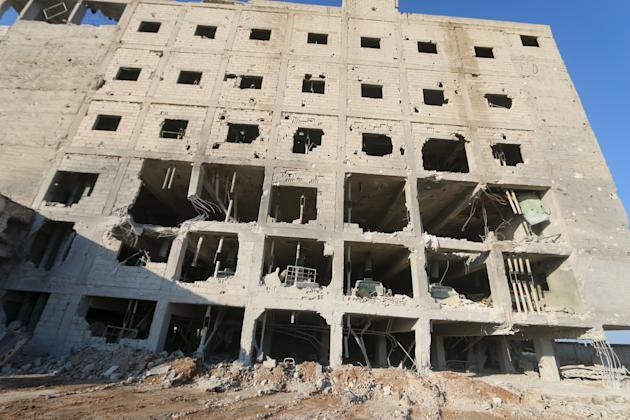 A damaged building hit by what local residents said were airstrikes carried out by the Russian air force on a Turkish grain mill factory is seen in the town of Saraqib, in Idlib province, Syria